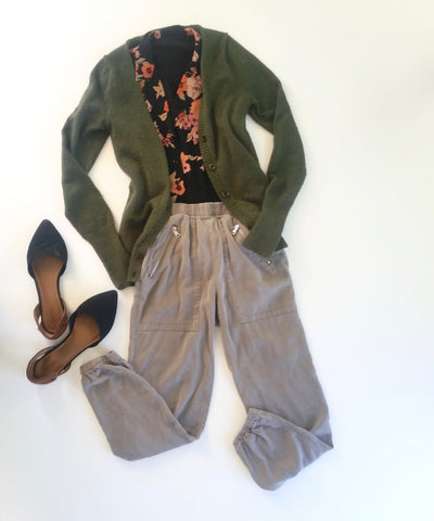flat lay: black and pink, floral, button up blouse, green cardigan, gray joggers, and black, pointed flats