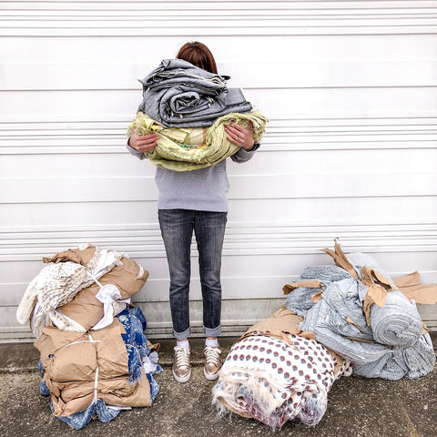 Alyssa Holding bundles of fabric from L.A. clothing manufacturer