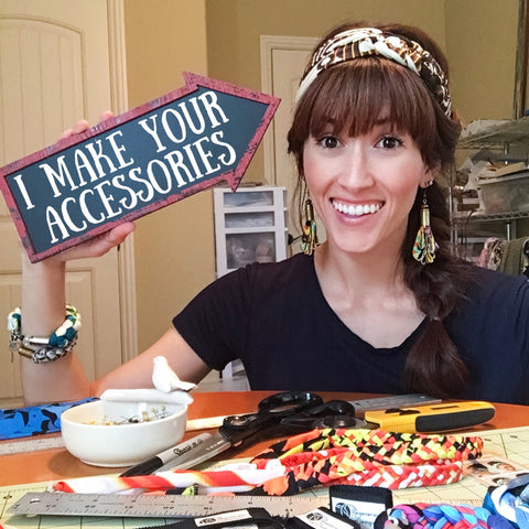 Alyssa Bird the owner and founder of Regenerous Designs. In her studio showing that she is the person behind the scenes that makes all the accessories by hand.