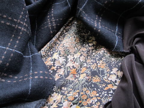 Neutral floral print fabric, black-brown-ivory wool plaid, grey and brown knit jersey fabric.