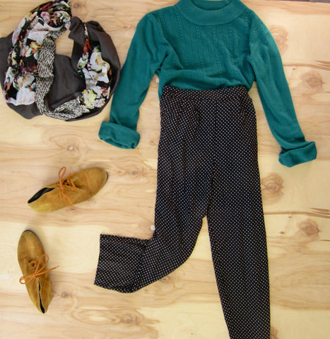 Flat lay: Black and white polkadot pants, teal turtleneck sweater, mustard colored shoes, and Regenerous Designs colorful floral infinity scarf.