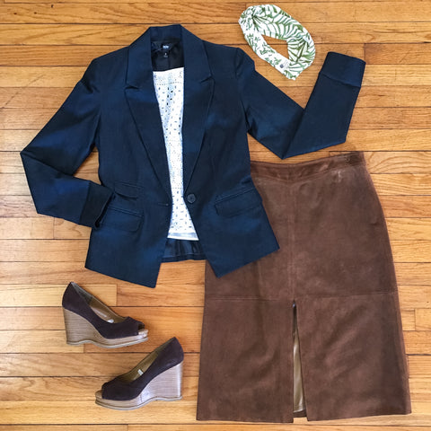 Flat lay: navy blazer, ivory crop top, light brown, suede skirt, dark brown wedges, and green and ivory Regenerous Designs headband.