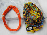 orange buttonband beside a yellow, turqouise, and brown big braided headband