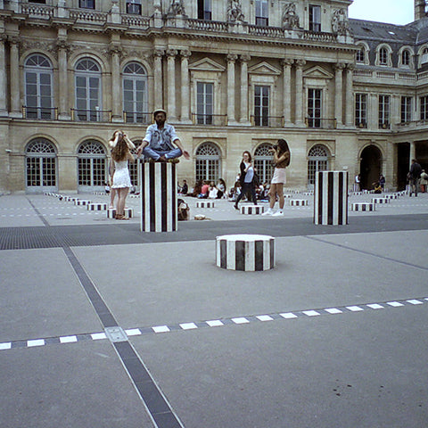 Travel with Father's Factory wooden digital camera. Capture the moment with father's factory camera for kids. picture shows the photographer's father sitting in a square in Paris. Little photographer took the photo with Father's Factory wooden digital camera.
