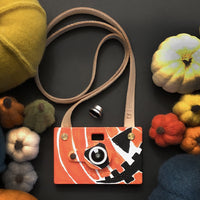 Father's Factory Woodcam is a working digital camera with handcrafted wooden case. Features 8 megapixel resolution. This vegan leather strap is a good addition for Father's Factory wooden digital cameras to prevent it dropping on the floor.