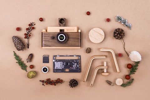Father's Factory classic one wooden digital camera comes in a holiday gift set. it includes a classic one digital camera and a display wooden tripod