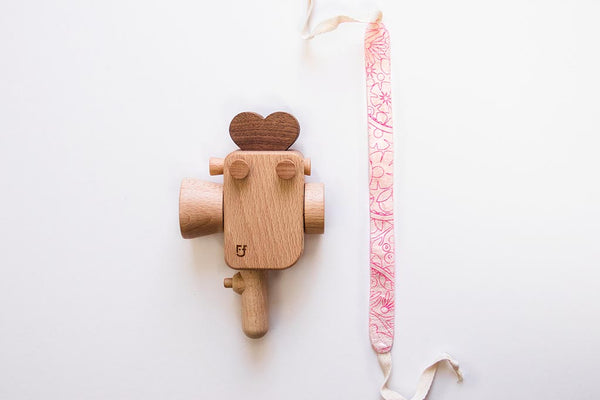 Handheld strap for Father's Factory Super 8 wooden toy camera. The strap is handmade in los angeles with much love. it allows your little videographer to bring their favorite toys with them everywhere! The Sweet Dream pattern is limited quantities and limited edition for Valentine's Day