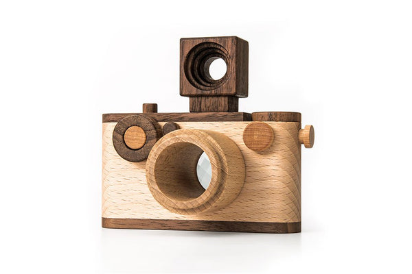 Father's Factory wooden toy camera, 35MM Original wooden toy camera with detachable magnetic flash, clickable button and kaleidoscopic lens. It's perfect of pretend play, sensory play, and homeschooling. It's made of walnut and beechwood with heirloom quality. Non toxic, natural, and environmental friendly toy. No Battery-Operated or Plastic Toys. Tested To Meet All Safety Standards. Perfect interior decor for kid's room.
