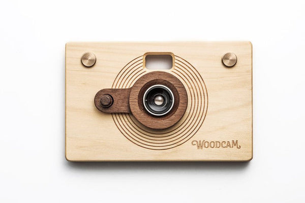 Father's Factory Woodcam is a working digital camera with handcrafted wooden case. Features 8 megapixel resolution, focus 35mm, aperture 2.8 standard.