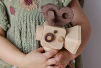 Father's Factory new super 16 Wooden Toy Camera is perfect for you! Stories play a vital role in the growth and development of children, and this Super 16 elevates the whole pretend-play experiences. The Super 16 handheld has a spinning rewind level, swivel lens, kaleidoscopic viewfinder, spinning shutter, and a handheld device for children to bring it everywhere.
