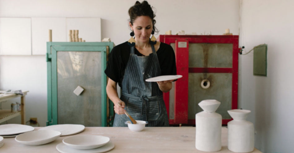 Klomp Ceramics founder Alexia Klompje creating handmade ceramic tableware. Available at Sarza home goods and furniture store in Rye New York.