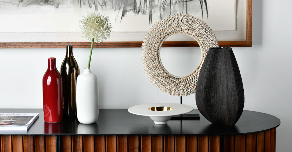 Vorster & Braye bowls and vases styled on a sideboard. Vorster & Braye ceramics are available at Sarza home goods, furniture & décor store in Rye