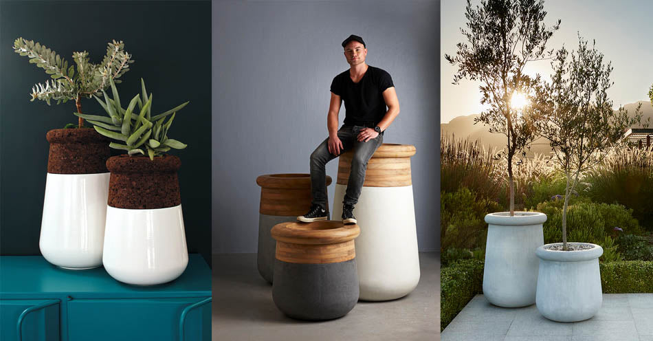 Indigenus planter designer, Laurie Wiid van Heerden, sitting alongside his planter designs. The planters are available at Sarza home goods, furniture & décor store in Rye