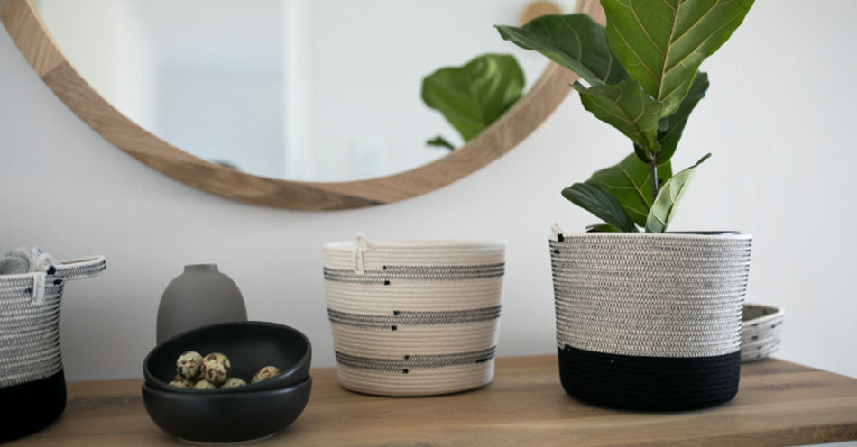 Mia Melange cotton baskets, planters and bowls styled on a sideboard. Mia Melange products available at Sarza home goods and furniture store in Rye New York.
