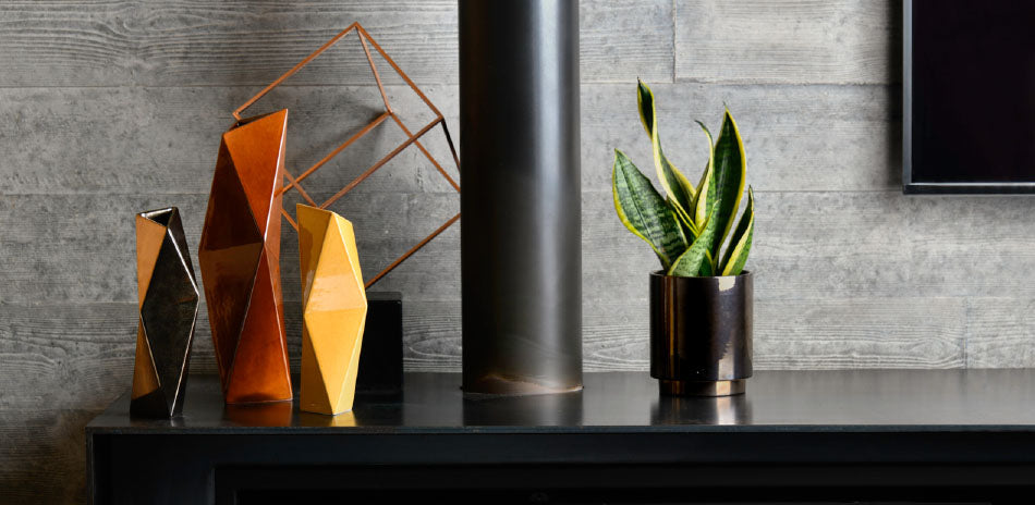 Vorster & Braye Facet vases styled on a side table.  Vorster & Braye ceramics are available at Sarza home goods, furniture & décor store in Rye