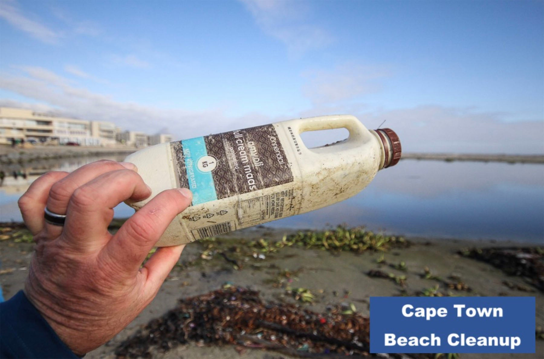 Photo of beach clean up in South Africa. The Cape Island brand supports this cause. Cape Island luxury candles, soap products and home fragrances are available at Sarza home goods and furniture store in Rye New York.