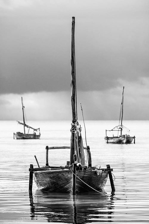 David Ballam wall art featuring fishing sail boats in Zanzibar. Available at Sarza home goods and furniture store Rye New York