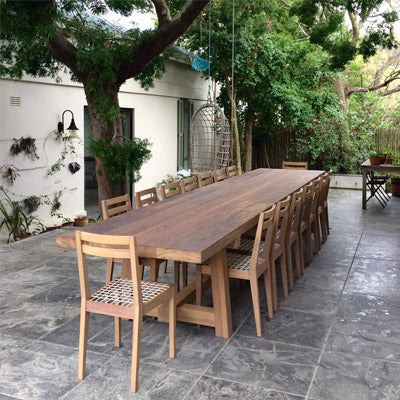 James Mudge outdoor dining table and chairs. The solid wood furniture is available at Sarza home goods, furniture & décor store in Rye