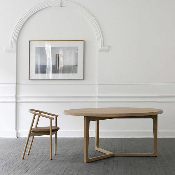 James Mudge round dining table and chairs. The solid wood furniture is available at Sarza home goods, furniture & décor store in Rye