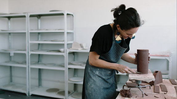 Klomp Ceramics founder Alexia Klompje creating handmade ceramic tableware in her studio.  Available at Sarza home goods and furniture store in Rye New York.
