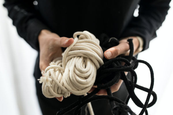 Mia Melange creates cotton home décor products. Image of sustainably farmed cotton rope held in hands. Mia Melange products available at Sarza home goods and furniture store in Rye New York.
