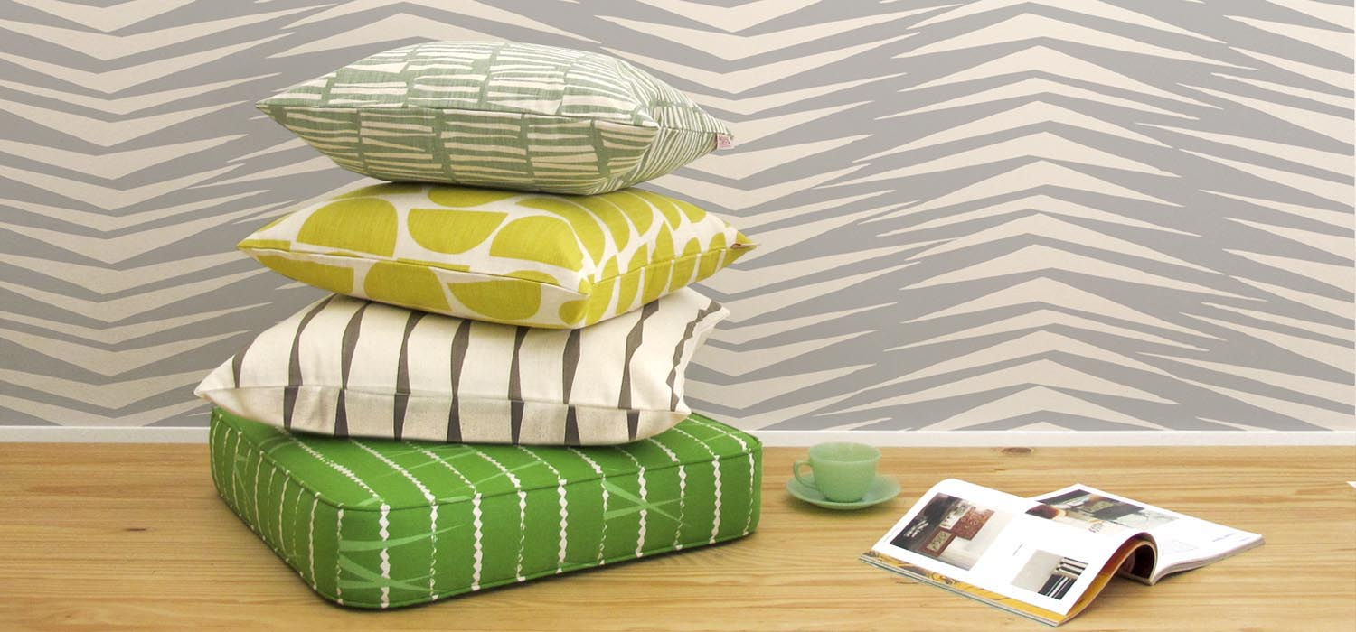 Skinny laMinx wallpaper and pillows in bright colors. Available at Sarza home goods and furniture store in Rye New York.