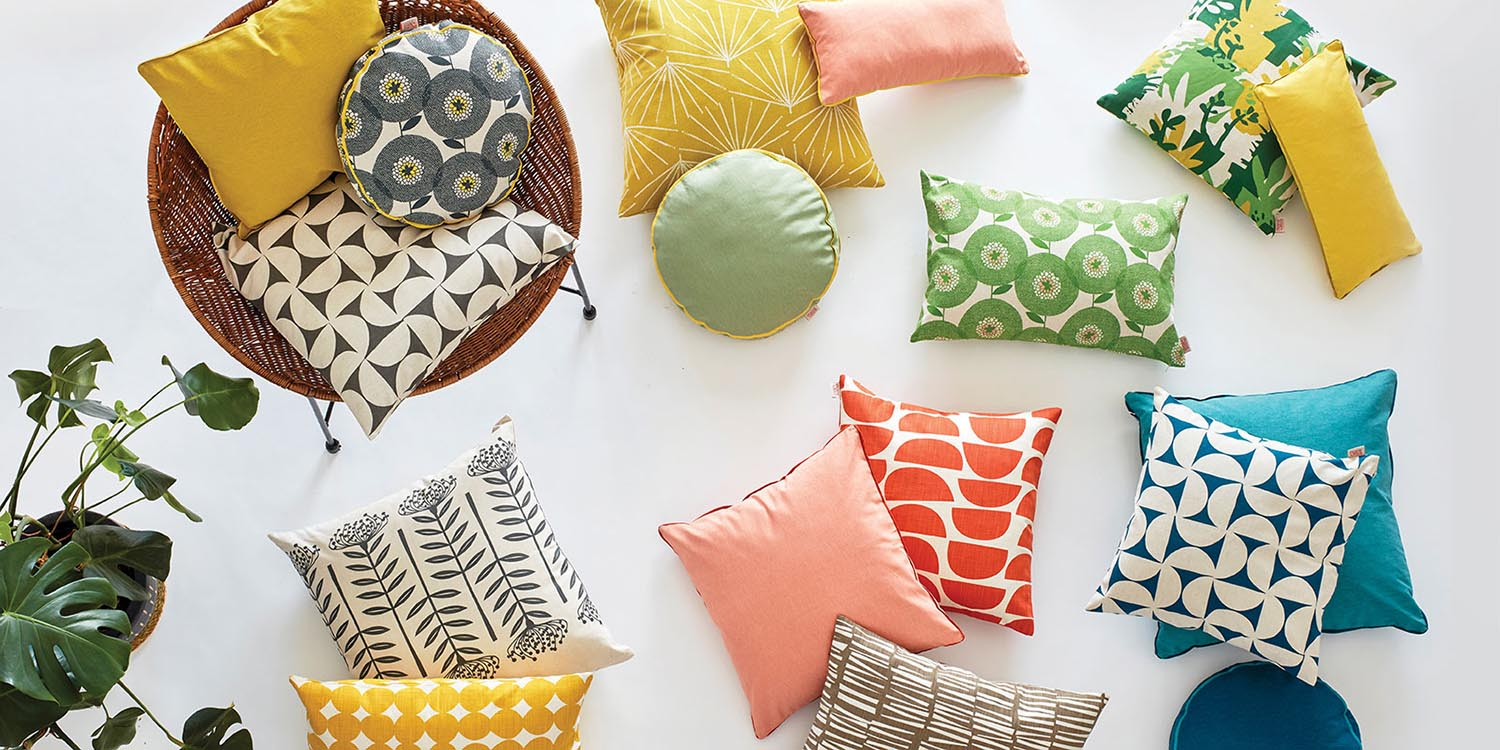A trio of Skinny laMinx pillows in bright colors and patterns. Available at Sarza home goods and furniture store in Rye New York.