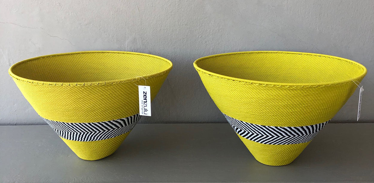 Image of ZenZulu yellow woven baskets as home décor products. ZenZulu baskets, plates and vessels are available at Sarza home goods and furniture store in Rye New York.