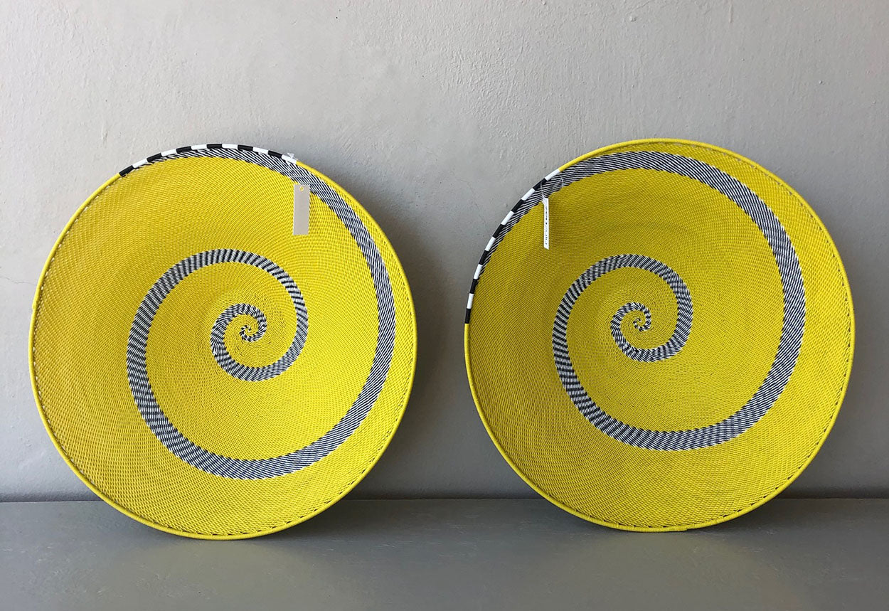Image of ZenZulu yellow black and white bowls, home décor products. ZenZulu baskets, plates and vessels are available at Sarza home goods and furniture store in Rye New York.