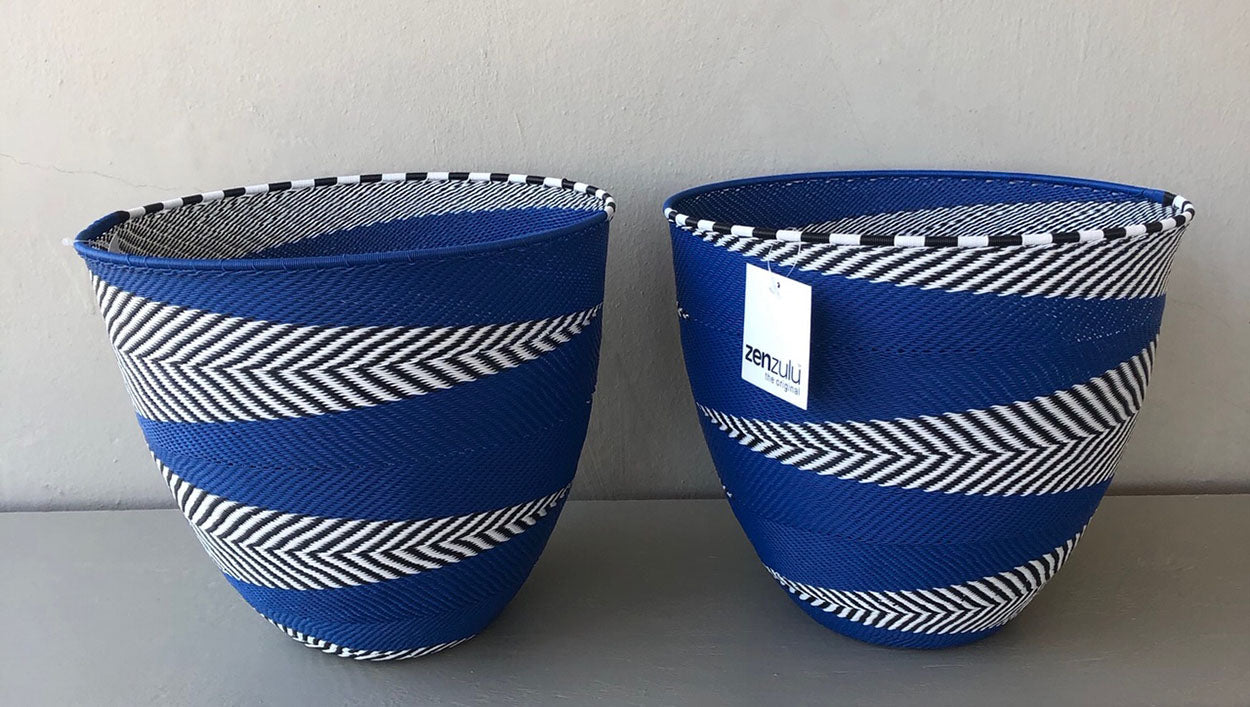 Image of ZenZulu blue and white woven baskets as home décor products. ZenZulu baskets, plates and vessels are available at Sarza home goods and furniture store in Rye New York.
