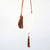ARIA SLING HANDBAG BY ILUNDI. A collaboration between Mia Melange and Ilundi Designs, the Aria Sling is made from ivory rope and brown leather with tassel detailing.