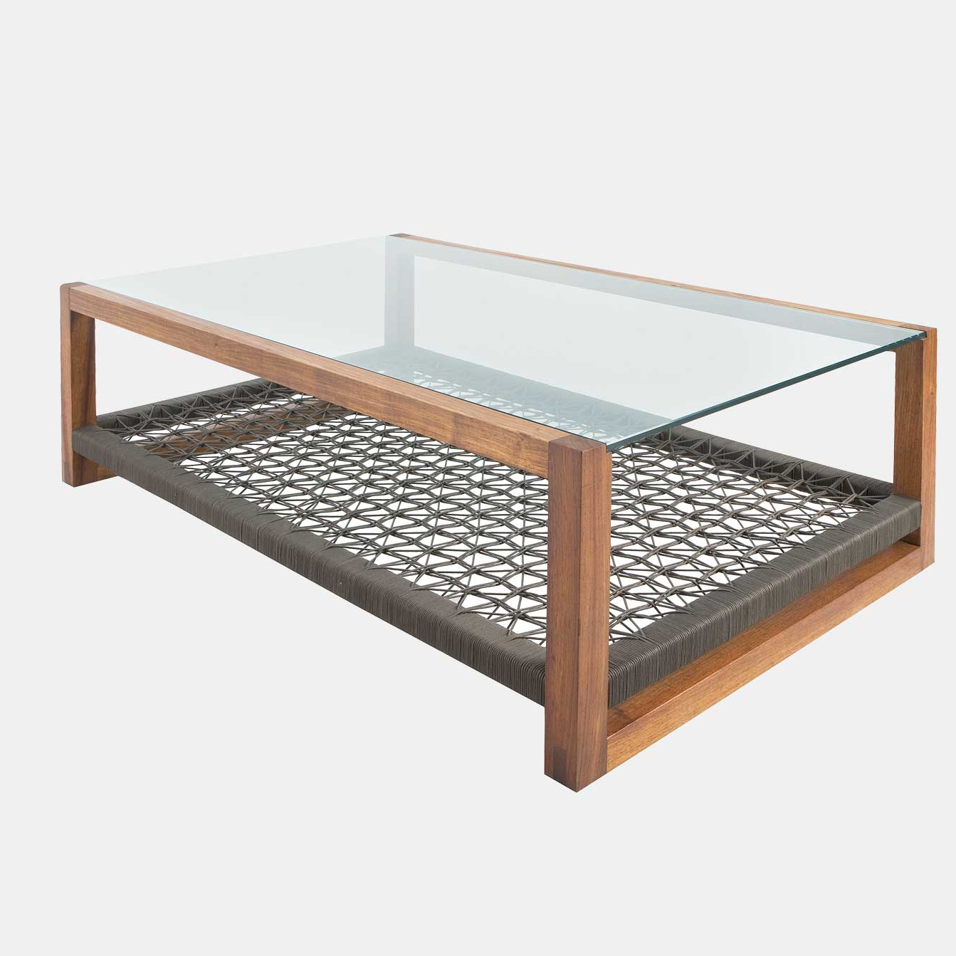 The Cube Coffee Table by Vogel Furniture Design. A solid wooden coffee table available in different timbers and stains with a glass top and customizable woven bottom shelf. You can change the weave & the coffee table becomes something completely different. It is shown here as a calm coffee table in muted tones, or it could be expressive and fun in bold colors.