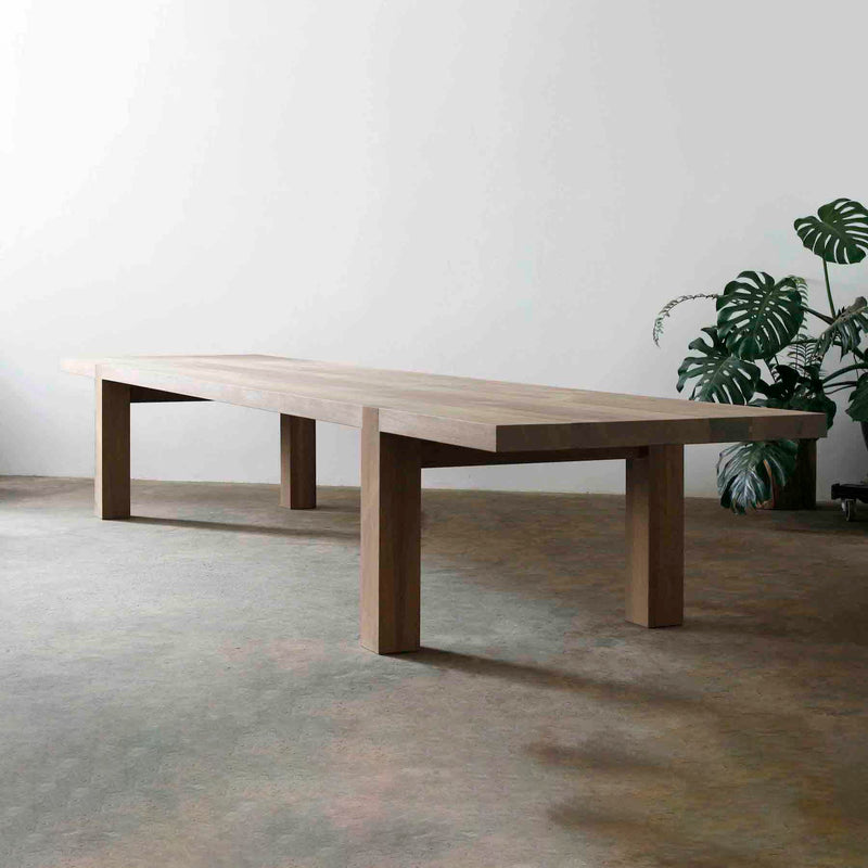 "CARPENTERS TABLE BY JAMES MUDGE. The rough finish & oil sealant give The Carpenter's Table its raw aesthetic charm. Made from 2.75"" thick French Oak or Iroko with removable legs."