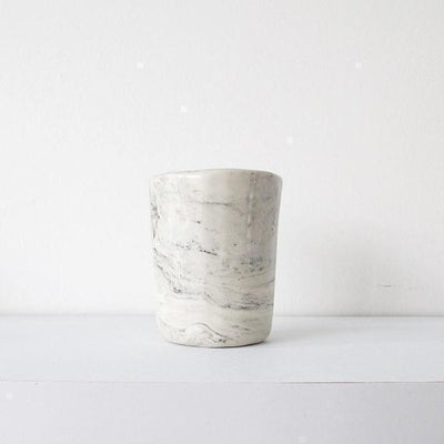 MARBLE CERAMIC CUP By Klomp Ceramics. A marbled black, white and grey stoneware cup. Clear glazed, unglazed underneath.
