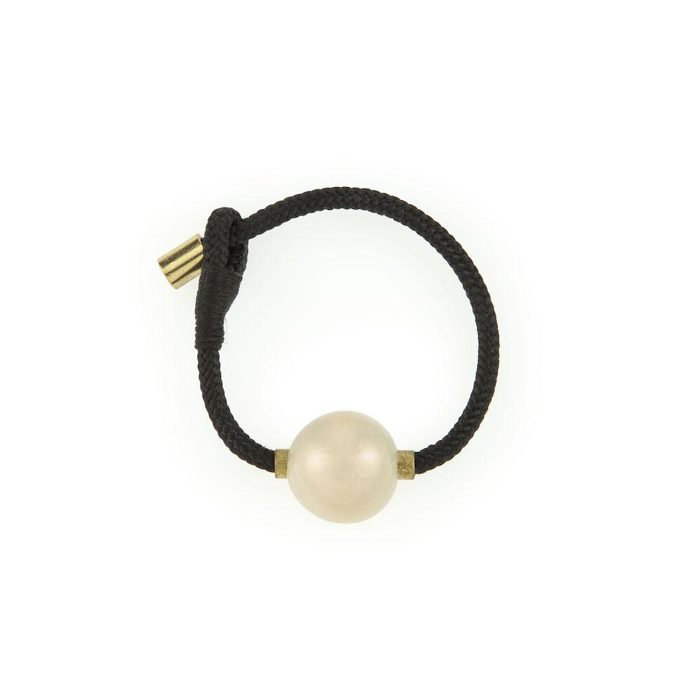ENSO PEARL CUFF - JEWELRY BY PICHULIK. Celebrating balance and beauty in stillness, this black rope cuff bracelet adorned with brass and a hand-painted, pearl-finished wooden bead.