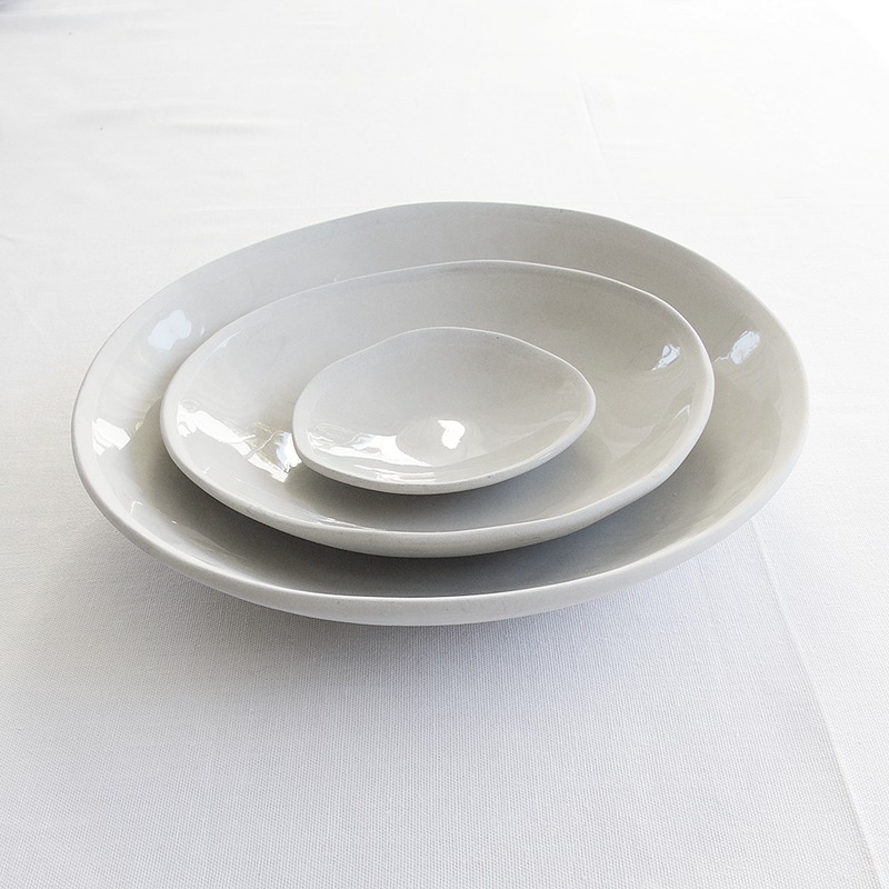 EVERY DAY RANGE GREY CERAMIC BOWL by Klomp Ceramics. Make everyday dining unique with this handmade grey stoneware everyday collection. Glazed on top, with an unglazed rim and underneath.