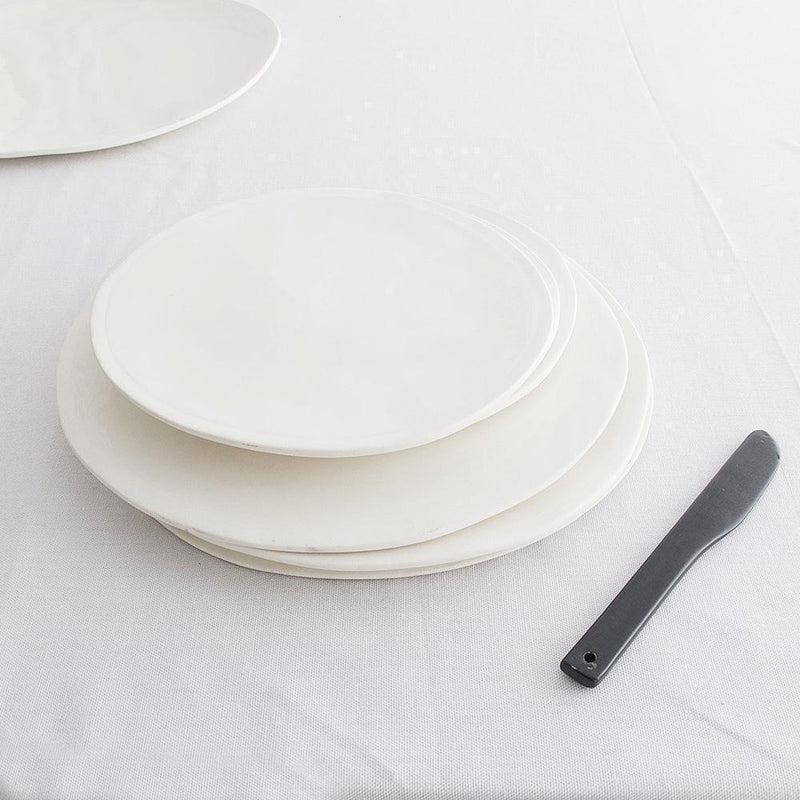 EVERY DAY RANGE WHITE CERAMIC PLATE by Klomp Ceramics. Make everyday dining unique with this handmade milky white stoneware everyday collection. Glazed on top, with an unglazed rim and underneath.