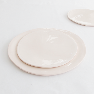 EVERY DAY RANGE PINK CERAMIC PLATE by Klomp Ceramics. Make everyday dining unique with this handmade light pink stoneware everyday dining collection. Glazed on top, with an unglazed rim and underneath.