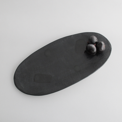 BLACK AS NIGHT PLATTER By Klomp Ceramics. A textured large platter. Part of our Black As Night serveware range. Hand glazed matte & gloss black finish on textured clay, with an unglazed white underneath.