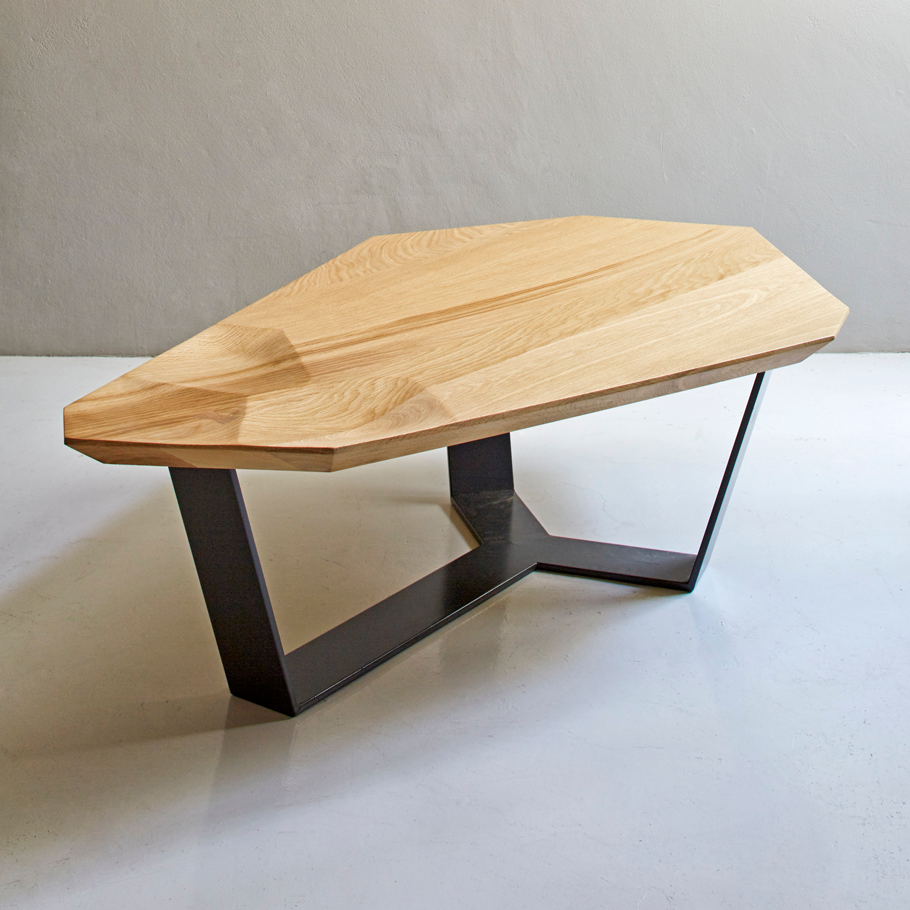 Mud Coffee Table by Meyer Von Wielligh. Inspired by Abrie's homeland of Namibia, and the cracked mud plates found on the dry riverbed of Sossusvlei, the angular, irregular shape of the Mud Coffee Table is constructed from cracked oak with traditional dove-tail details combined with the solidity of steel legs.