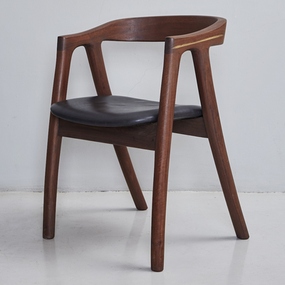 Umthi Dining Chair by Meyer Von Wielligh. The design allows the wood to dictate its natural form. The Umthi Dining Chair is inspired by the organic lines of tree branches.