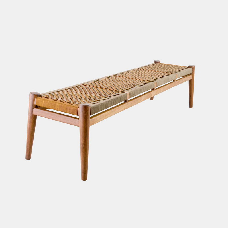 The Nguni Bench 4 Seat by Vogel Design. Available in a selection of timbers and a customizable woven base is available in an assortment of patterns, weaves and colors.