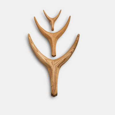 The Nguni head in Iroko Timber by Vogel Design. Can be used as wall art or hook. Can be hung as a collection or individually. Available in 3 sizes & different timber options.