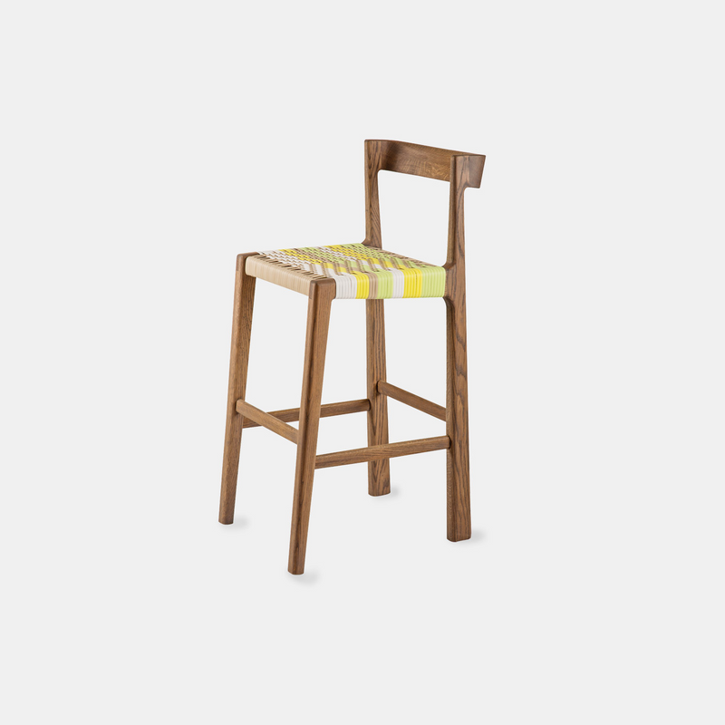 The Odi Barstool by Vogel Furniture Design. Made from a selection of timbers and finishes, it features a comfy woven base, in an assortment of patterns, weaves and colors.