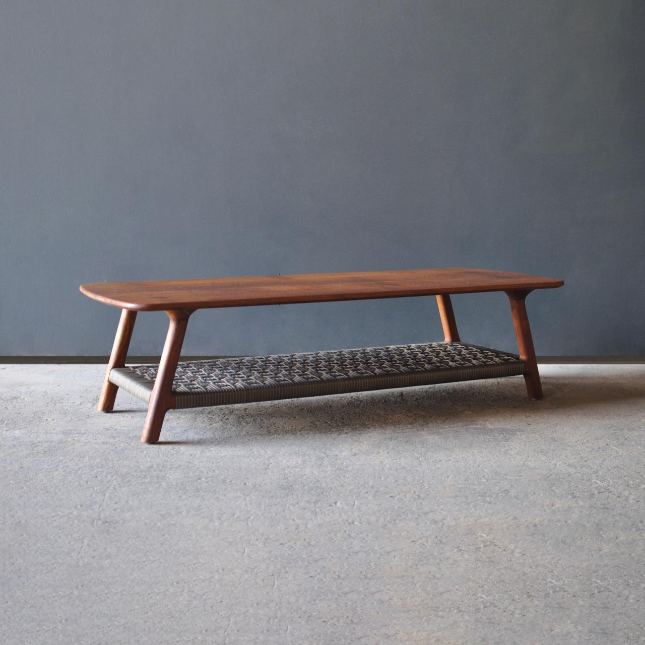 One Tribe Coffee Table by Vogel Design. The idea behind the One Tribe is that the design lends itself to being chameleon-like, by changing the weave of the shelf at the bottom, this coffee table becomes something completely different.