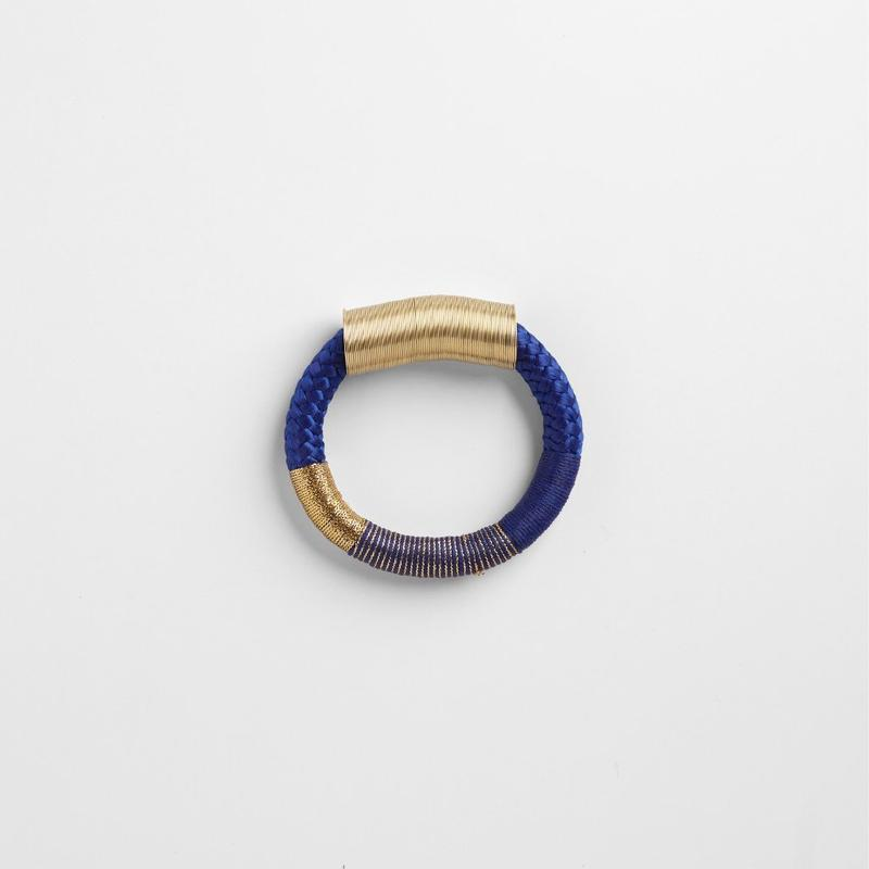 SLINKY BRACELET - JEWELRY BY PICHULIK. A simple strand of rope, decorated with gold cylinder and a multitude of colours.