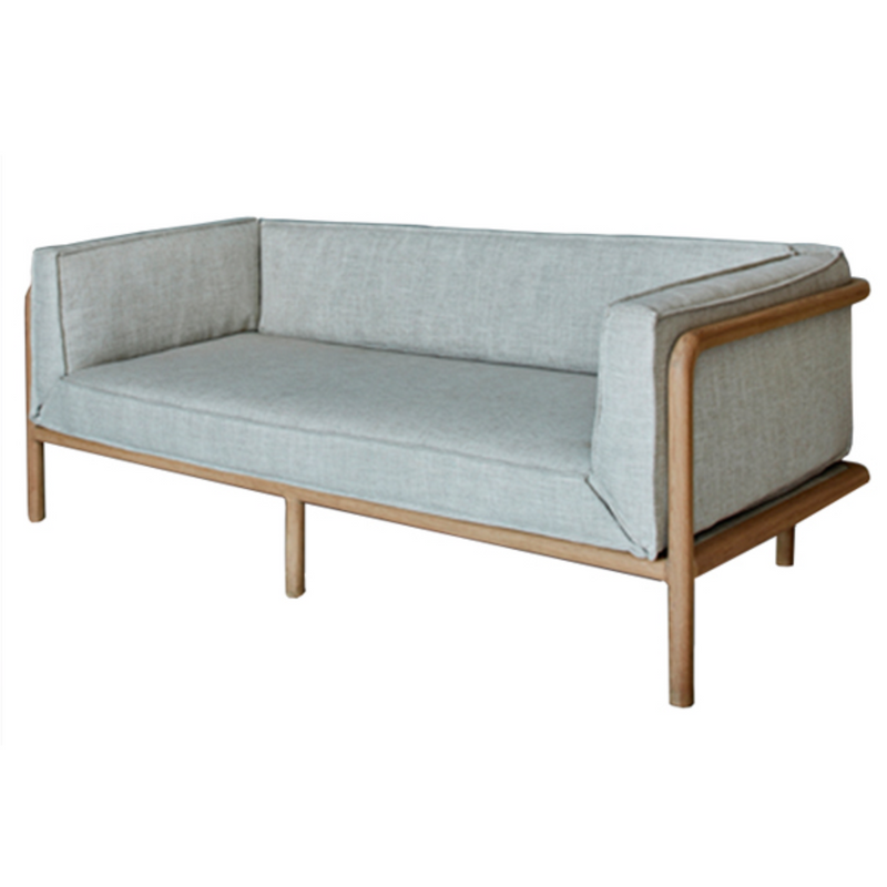 Melike 2 Seater Sofa by Meyer Von Wielligh. Inspired by the stark beauty of the Namibian landscape where Abrie grew up, the Melike chair is an uncomplicated design imbued with a simplicity in both material and detail.