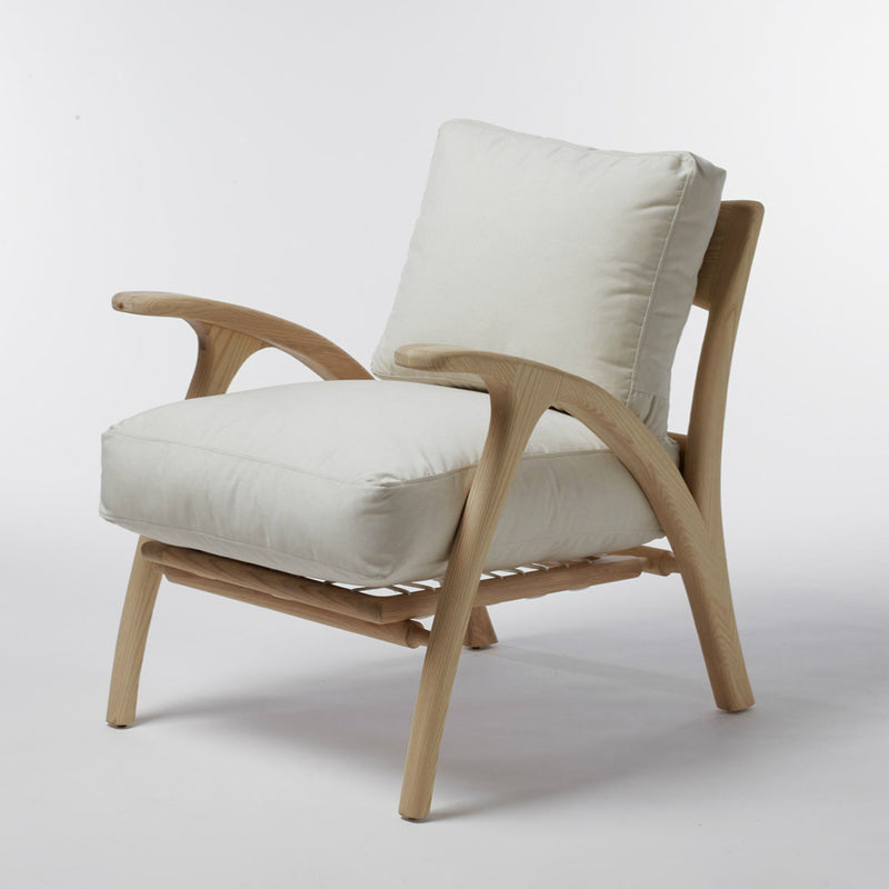 Umthi Lounger by Meyer Von Wielligh. Inspired by natural the organic design of the Umthi lounger is focused on the materials and allows the wood to dictate its natural form.