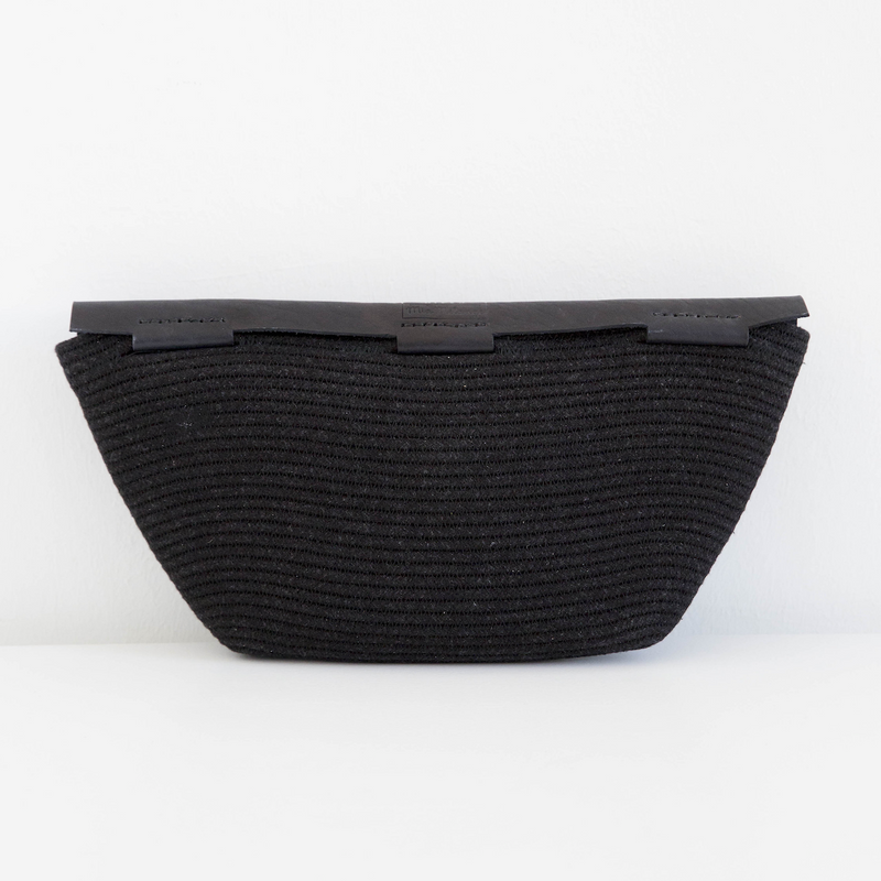 LUNA CLUTCH HANDBAG BY ILUNDI. The result of a collaboration between Mia Melange and Ilundi Designs. This beautiful clutch is made from black cotton and black stained leather. Made in South Africa.