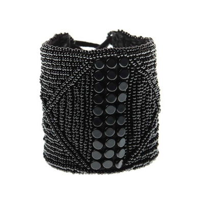 WIDE LEATHER CUFF -  JEWELRY BY SIDAI DESIGNS. An intricately beaded leather bracelet from our Sipolio collection. This collection shares the journey of boyhood to warriorhood of a young Maasai male, who wears black and adorns himself with white beaded jewelry and detailed face markings.